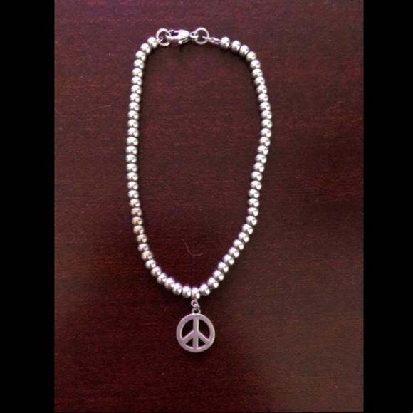 f05fa6a74e829 Tiffany & co. Silver peace sign bracelet